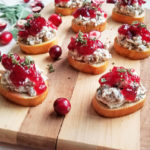 turkey-sausage-cream-cheese-on-crostini-with-red-cranberry-sauce-on-top