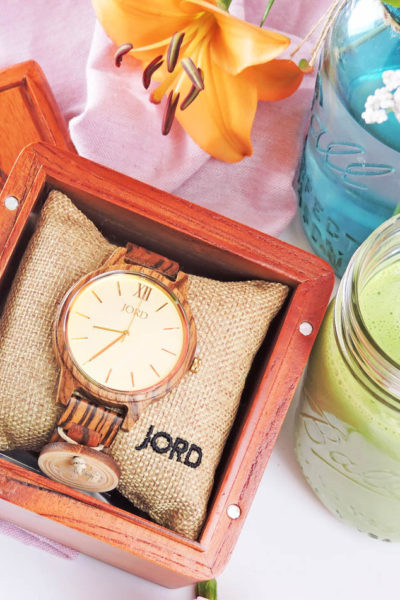Take Time For You with JORD Wooden Watches-Frankie Zebrawood & Champagne JORD watch in a wooden case next to a green smoothie and Spring flowers