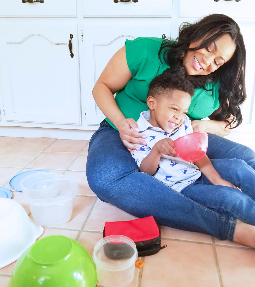 Just Call Me SuperMom-Hefty. African American (Black) mom and son laughing on kitchen floor
