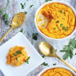 Savory Carrot & Spud Soufflé in a white bowl with parsley on top, made with Idaho Spuds VeggieMash