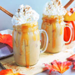 Spiked Caramel Pumpkin Cold Brew served in a mason jar with caramel, whipped cream, pumpkin spice and a cinnamon stick
