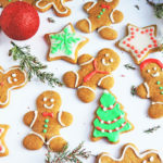 Irresistible Chewy Gingerbread Cookies, gingerbread cookies decorated with vegan royal icing and Christmas decorations, on a white surface