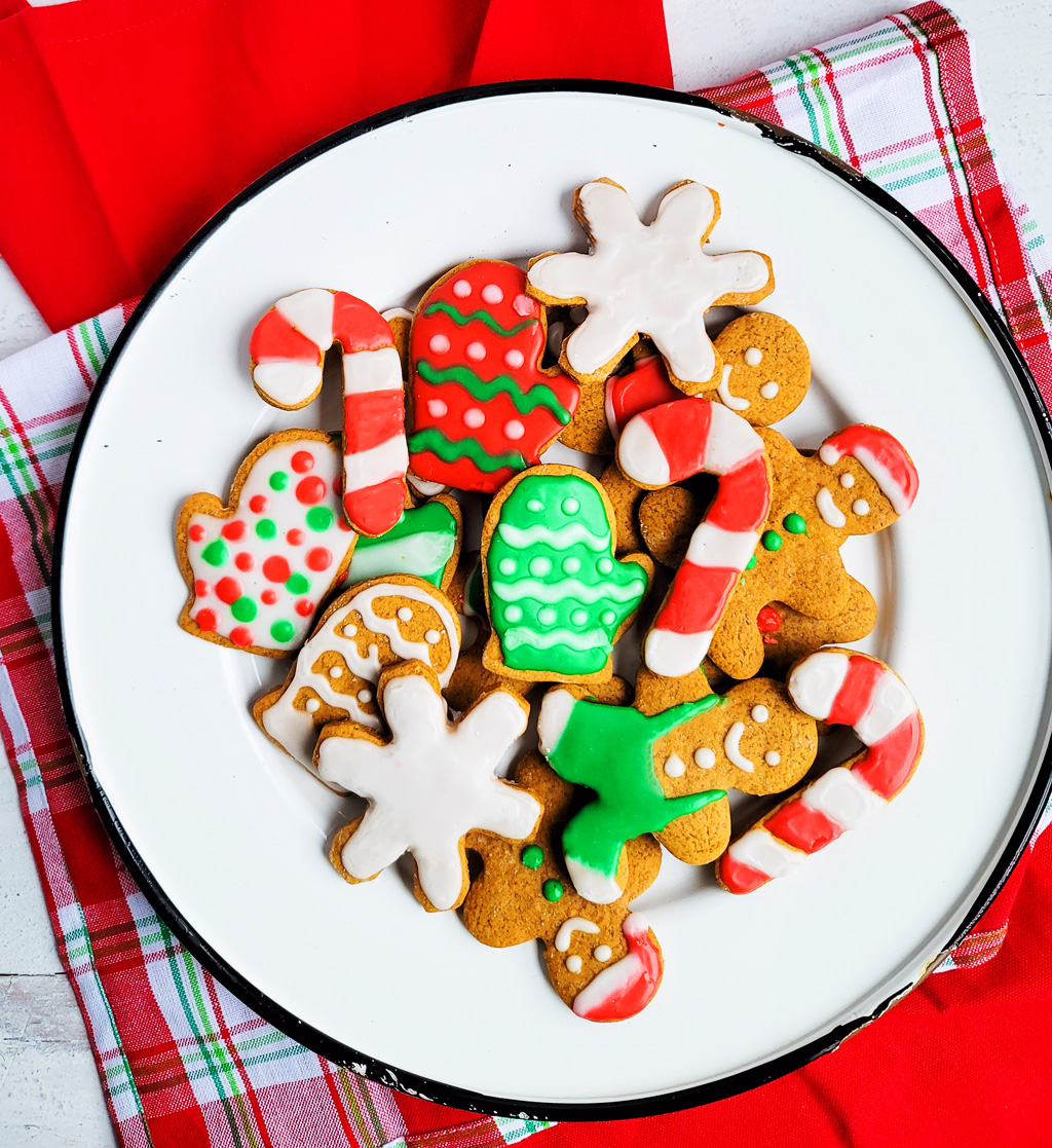 decorated gingerbread cookies with Christmas colors, red and green, on a white plate. Beautifuleatsandthings.com
