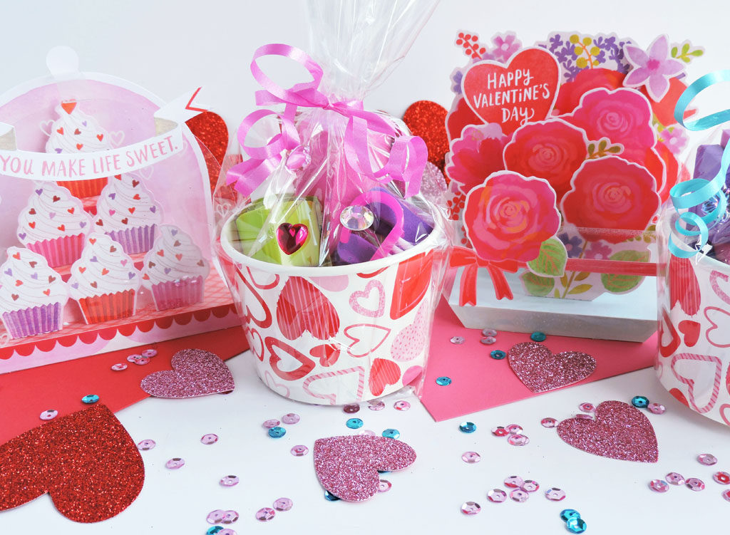 Valentine's Day Gift Exchange-Mini DIY Nail Spa Kits. sparkly nail file, nail clippers, nail polish in a valentine's cup paired with Hallmark Paper Wonder and Hallmark Signature Cards.