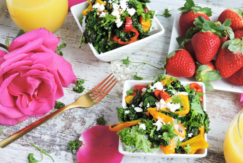 last minute romantic valentine's day ideas-breakfast in bed with kale breakfast bowls, strawberries, and mimosas on a white surface