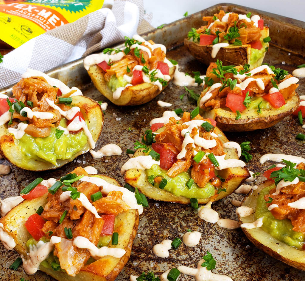 Vegan Tex-Mex Loaded Potato Skins topped with guacamole, diced tomatoes, The Jackfruit Company Tex-Mex, chives, and vegan ranch dressing  beautifuleatsandthings.com
