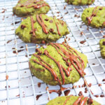Gluten Free Matcha Mint Chocolate Chip Cookies, green cookies with a chocolate drizzle on a cookie rack beautifuleatsandthings.com