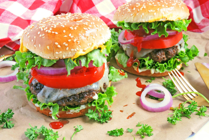 Thai Peanut Butter Grilled Burgers made with creamy peanut butter on brown paper and a red and white checkerboard tablecloth