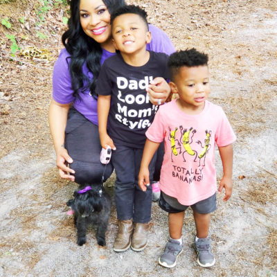 Fun Ways to Keep Your Family Active this Summer, African American family walking outside with black maltipoo dog
