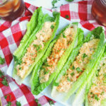 Cajun Herb Egg Salad served in romaine lettuce wraps on a red and white checkerboard tablecloth