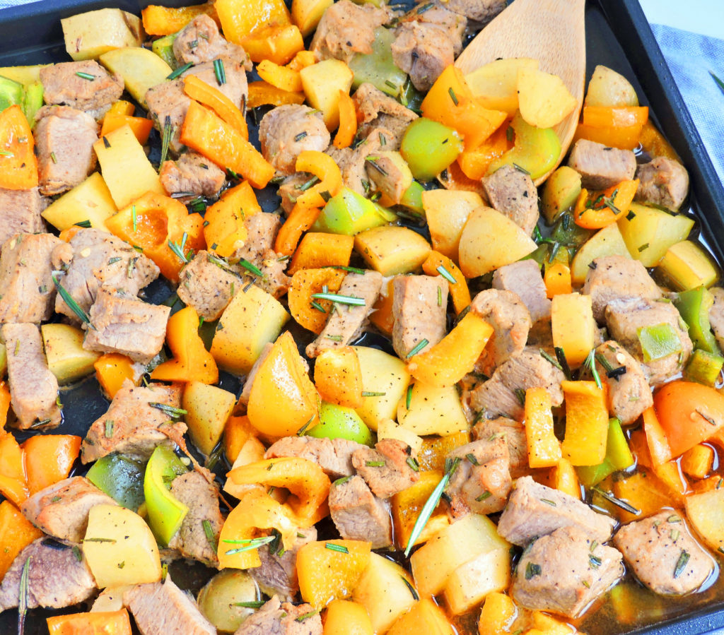Honey Balsamic Pork & Veggie Sheet Pan Meal on a white surface made with the Ninja® Foodi™ Digital Air Fry Oven.