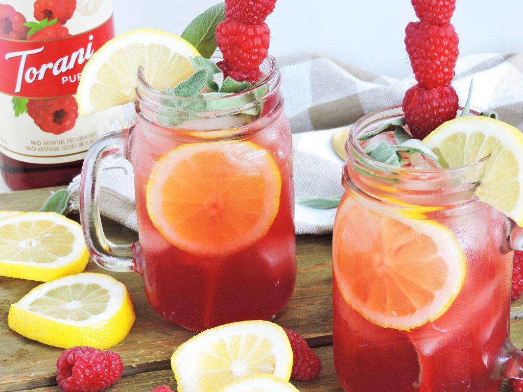 Raspberry Lemon & Mint Kombucha Cocktail made with Torani Puremade Raspberry Syrup, in a mason jar