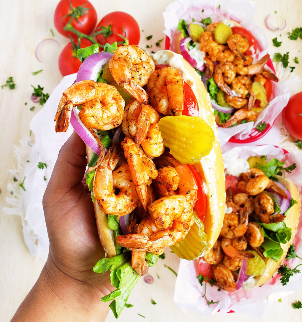 Cajun Lightened-Up Grilled Shrimp Po' Boys, hoagie roll with lettuce, tomatoes, purple onions, pickles, grilled shrimp and tartar sauce