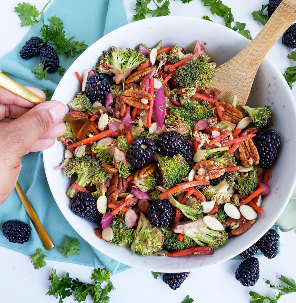 Vegan Blackberry Broccoli Salad made with Oregon blackberries, pecans, almonds, and carrots in a white bowl