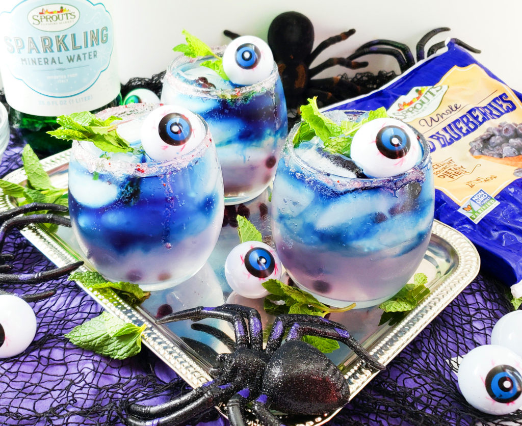 Sparkling Blueberry Mint Lemonade Cocktail in a stemless wine glass with fresh mint and plastic eyeballs, perfect for Halloween