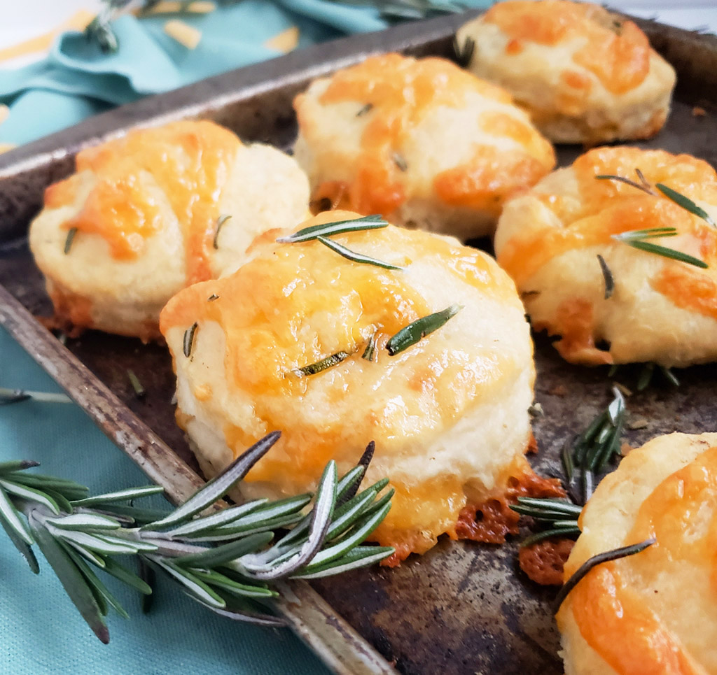 Fluffy Rosemary Cheddar Biscuits made with Tillamook cheese, perfect for the Holidays, thanksgiving and Christmas #homemadebiscuits #cheddarbiscuits #rosemarybiscuits