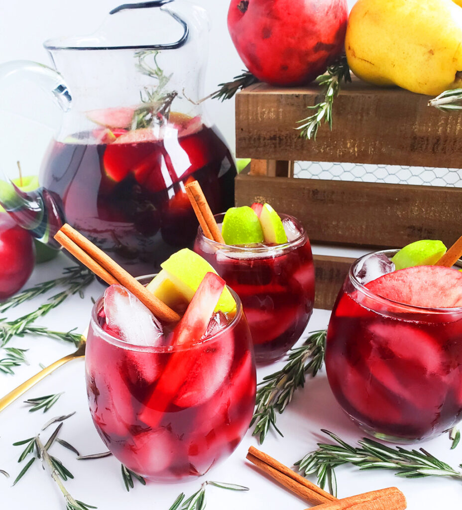 Spiced Harvest Fall Sangria made with apples, pears, plums, cinnamon & spices, perfect for Autumn and Thanksgiving Holiday Parties. #fall #fallsangria #autumnsangria #thanksgivingcocktail