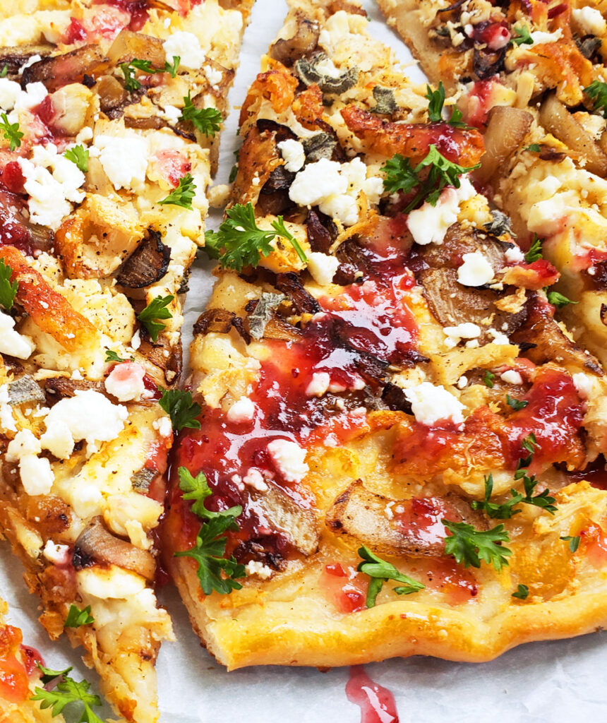 Roasted Turkey, Feta, & Cranberry Pizza made with Thanksgiving leftovers and a cranberry vinaigrette.