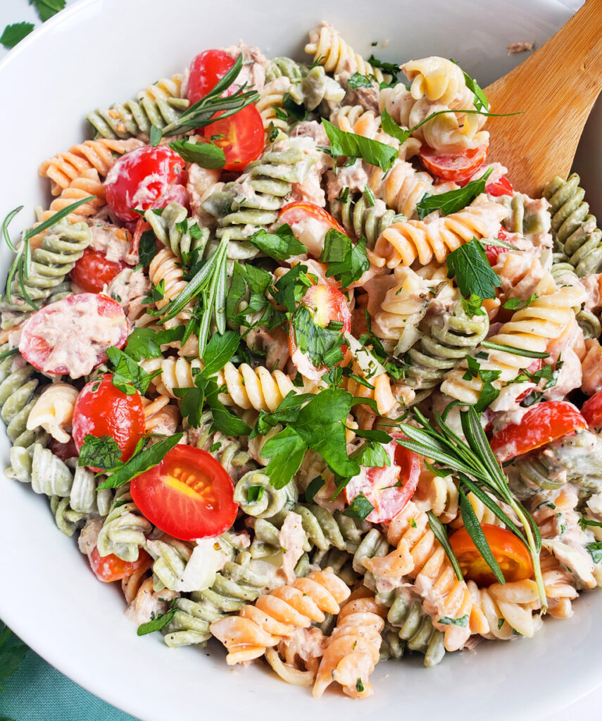 creamy herb tuna pasta salad made with  tri-color noodles and hellmann's light mayo