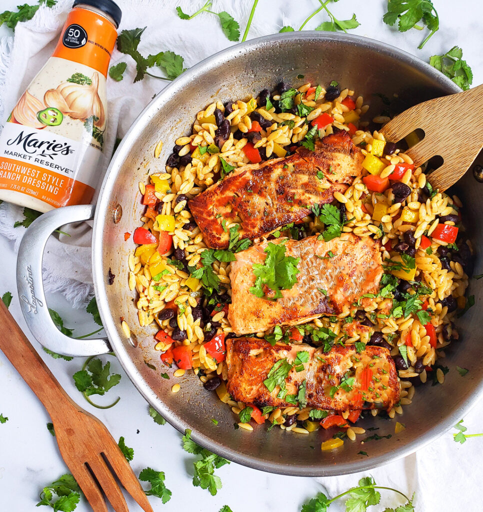 Southwestern Salmon  and Orzo made with black beans, corn, red bell peppers, and Marie's Market Reserve Southwest Style Ranch Dressing in a large pan