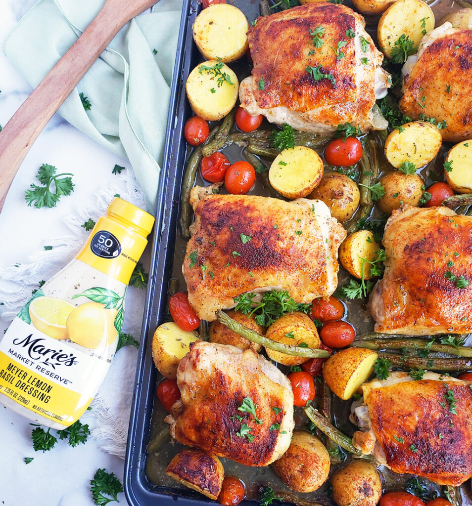Sheet-Pan Lemon Basil Roasted Chicken & Vegetables made with Marie's Market Reserve Meyer Lemon Basil Dressing. Perfect easy, weeknight sheet pan meal. #healthysheetpanmeals #sheetpanmeals #lemonchicken #chickenandvegetables #healthydinnerrecipes