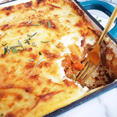 Easy Classic Shepherd's Pie made with tender ground lamb, lots of veggies which can be found right in your pantry, and instant mashed potatoes. Perfect for St. Patrick's Day.