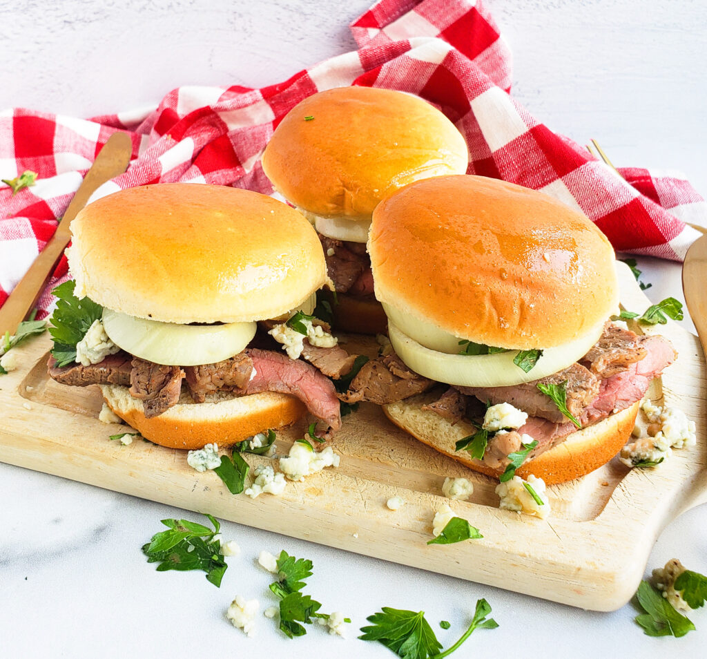These Grilled Steak Sliders with Onions & Blue Cheese are the perfect addition to your summer grilling menu. #summergrilling #summermenu #summerrecipes #sliders #sliderrecipes #steaksliders beautifuleatsandthings.com