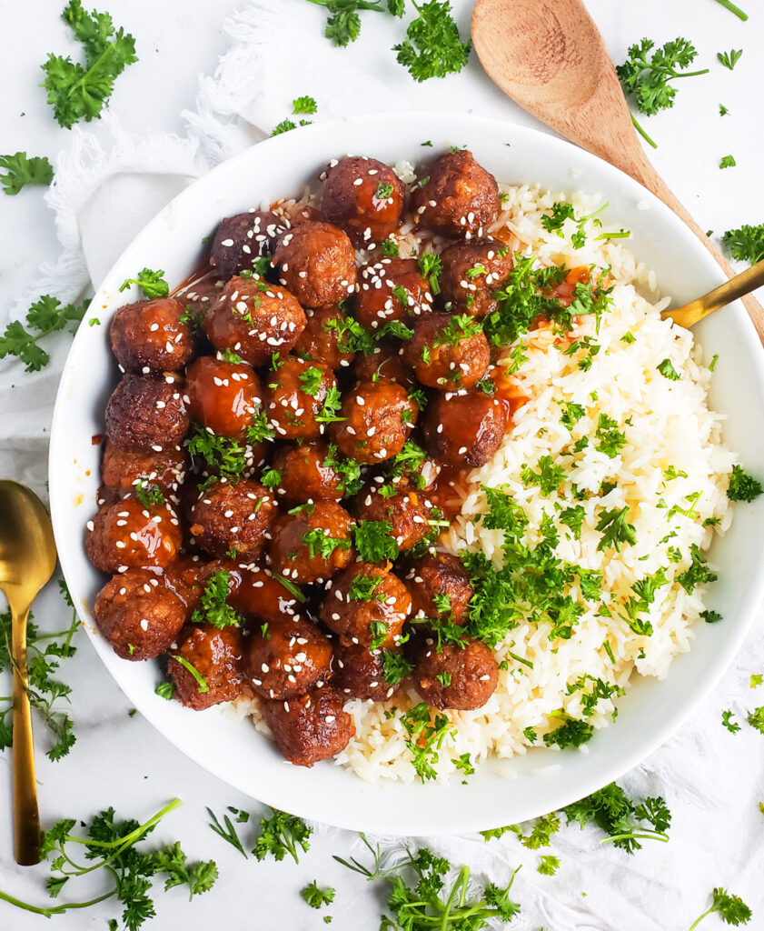 "If you're looking for a delicious, vegetarian dish that the whole family would love, try making this Sweet & Tangy Sesame ""Meatballs"" & Rice recipe made with FarmRich plant-based meatballs. #sweetandsour #sweetandsourmeatballs #sweetandtangy #sweetandtangymeatballs beautifuleatsandthings.com"