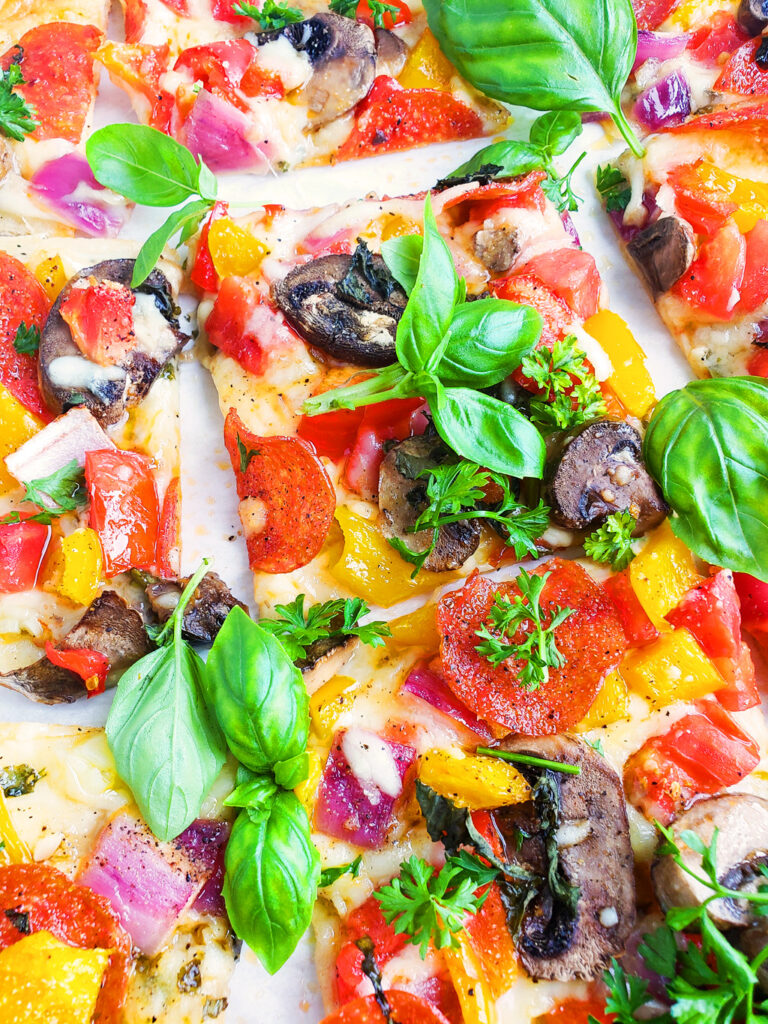 This Garden Fresh Veggie Pepperoni Pizza is the ultimate summer dinner! Quick & easy to make, and it's packed with tons of flavor from the fresh veggies, pesto, and herbs. #healthypizza #pizzanight #healthyrecipes #dinnerrecipes beautifuleatsandthings.com
