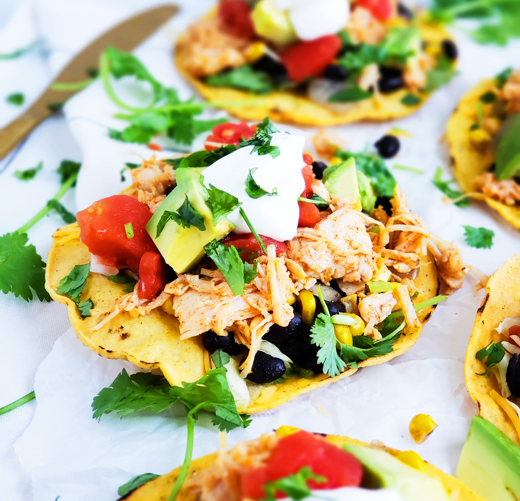 These Easy 15-Minute Chicken Tostadas are made with canned chicken, canned tomatoes, corn, black beans, avocado, and sour cream. Beautifuleatsandthings.com
