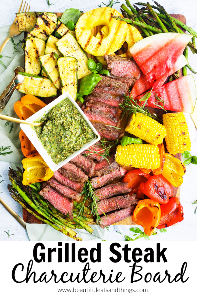 This Grilled Steak Charcuterie Board is piled high with tender NY Strip Steak, grilled asparagus, grilled zucchini, grilled bell peppers, grilled watermelon, grilled pineapple, and grilled corn. Perfect for entertaining. www.beautifuleatsandthings.com