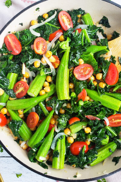 If you're looking for a healthy, wholesome meal, try this Sautéed Kale with Chickpeas, Okra, & Tomatoes in a white skillet! Perfect for meal planning. Beautifuleatsandthings.com