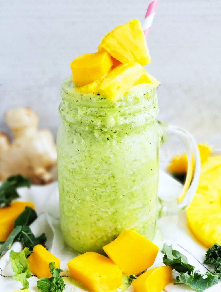 This immune-boosting Kale Mango Pineapple Ginger Smoothie is ready in less than 5 minutes and is packed full of tasty, nutritious goodness!