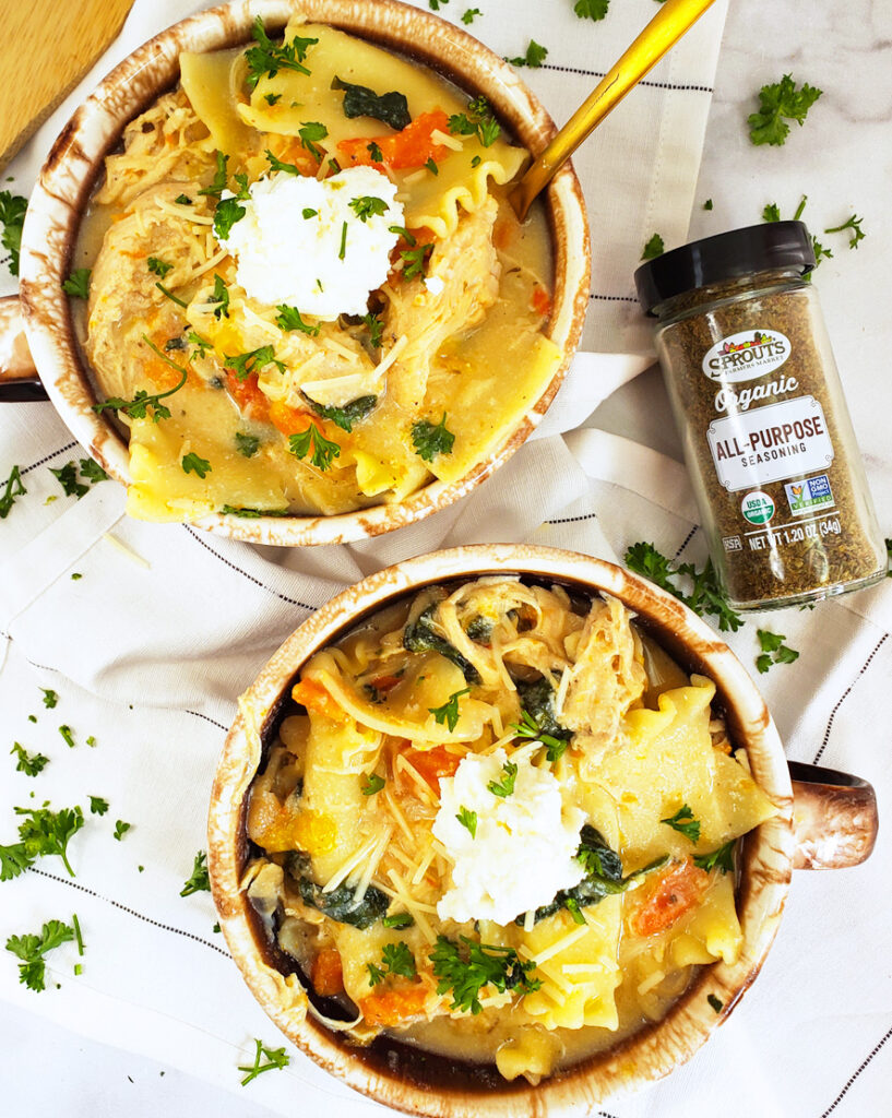 This Creamy White Chicken Lasagna Soup is the perfect recipe for Fall! It's made in your Instant Pot or Pressure Cooker and filled with carrots, bell peppers, chicken, white beans, and spinach. Beautifuleatsandthings.com