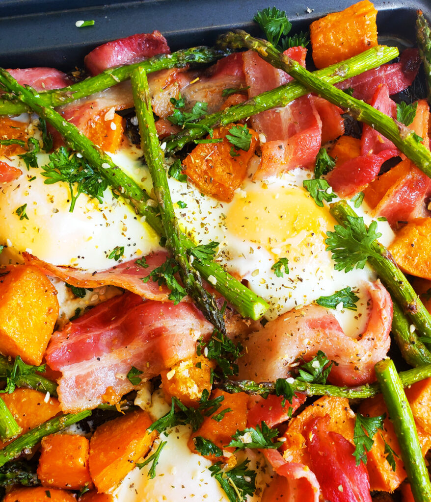 This Sheet-Pan Eggs with Bacon, Asparagus & Sweet Potatoes is the best recipe yet! It contains asparagus, bacon, sweet potatoes, and sunny-side-up eggs on a sheet pan. beautifuleatsandthings.com