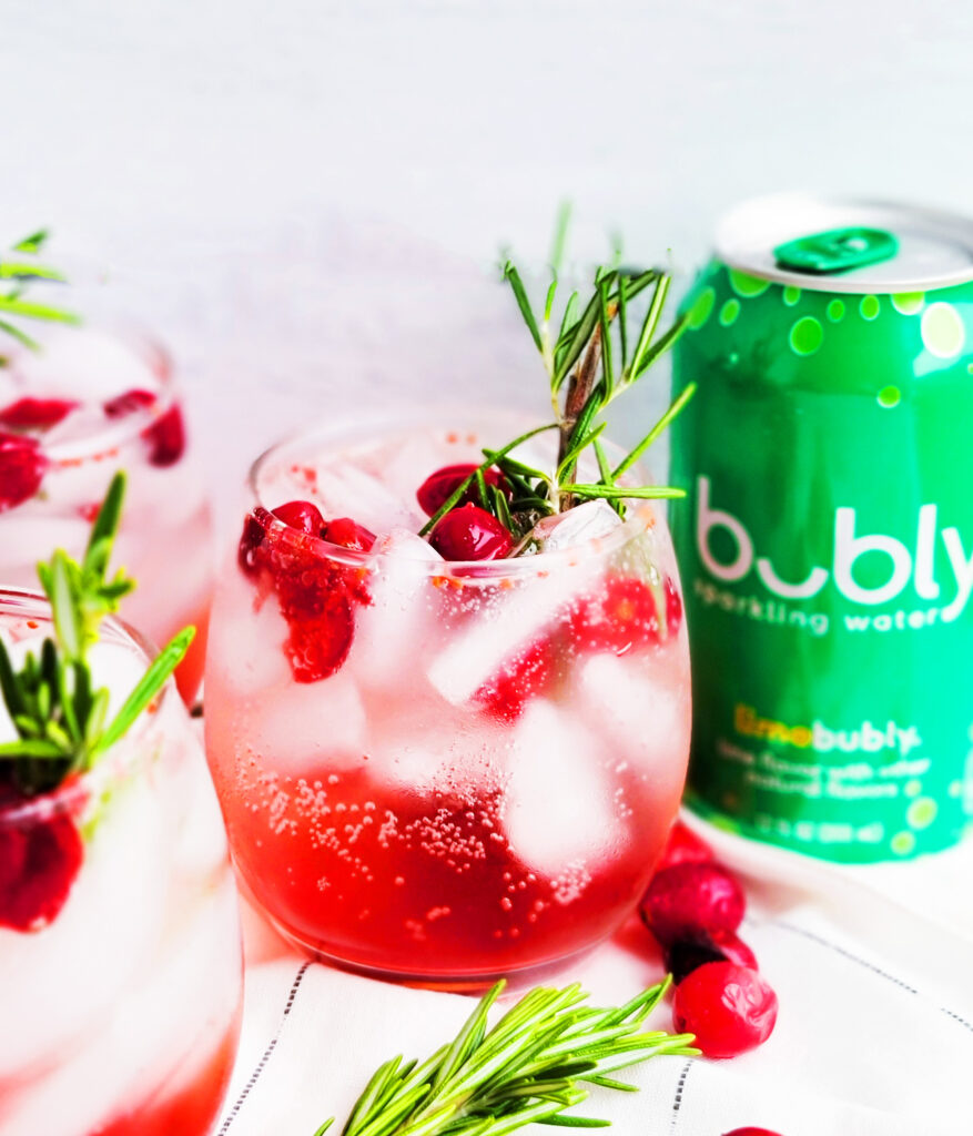 This Sparkling Cranberry Lime Mocktail is a great way to welcome the holidays with open arms! It's full of bubbles with a hint of lime, cranberry, and rosemary. beautifuleatsandthings.com