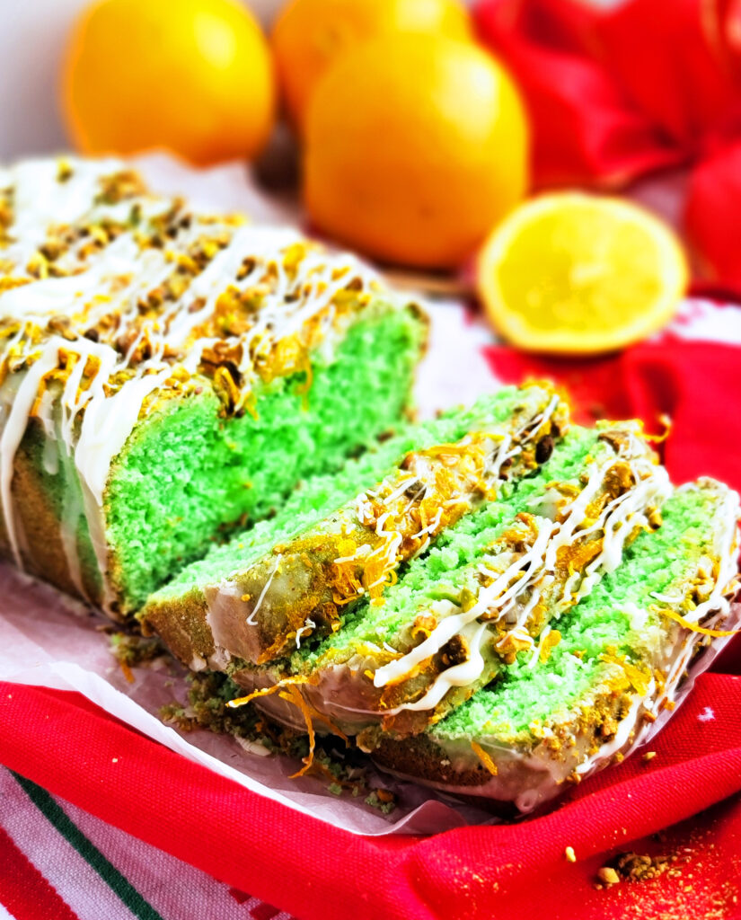 Easy green Grinch Cake made with oranges and pistachios, perfect for Christmas and the holidays. Recipe by www.beautifuleatsandthings.com