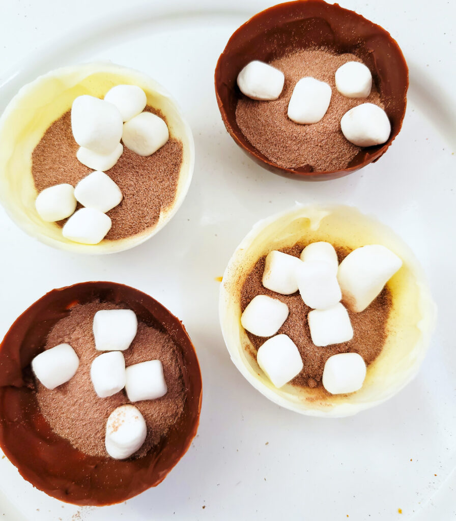 These Decadent Hot Chocolate Bombs (hot cocoa bombs) make the perfect DIY holiday gift. Packaged in a cardboard container, drizzled with white chocolate and milk chocolate. www.beautifuleatsandthings.com