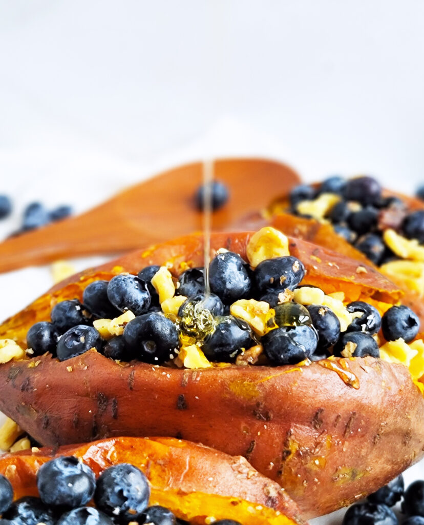 Blueberry & Walnut Stuffed Sweet Potatoes made with baked sweet potatoes, fresh blueberries, walnuts, and honey.  beautifuleatsandthings.com