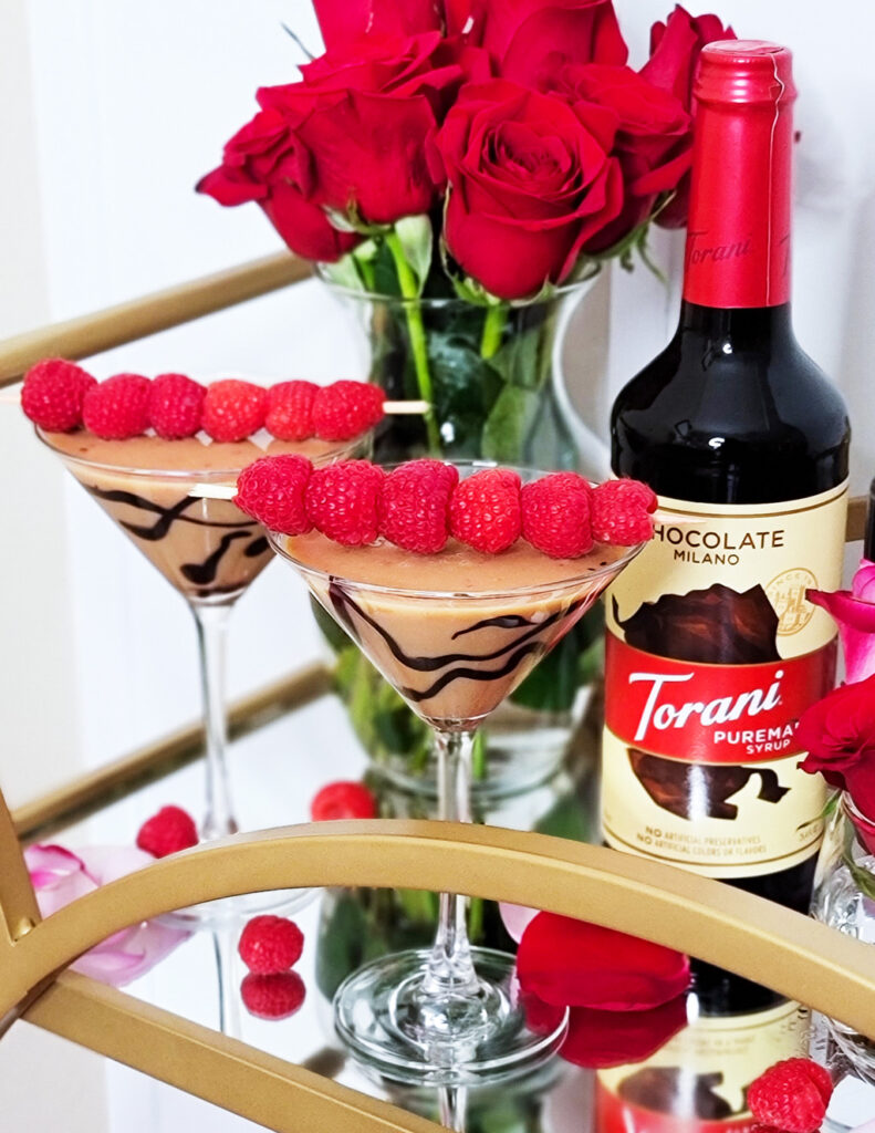 Finish off the meal with this decadent Double Chocolate Raspberry Martini served in a martini glass with a skewer of raspberries on top, made with Torani chocolate. Valentine's day cocktail. beautifuleatsandthings.com
