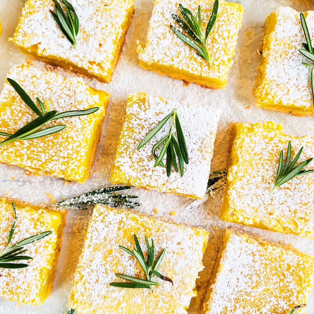These Easy Rosemary Lemon Bars are made with a soft, shortbread crust, infused with rosemary and a smooth, creamy lemon filling  beautifuleatsandthings.com