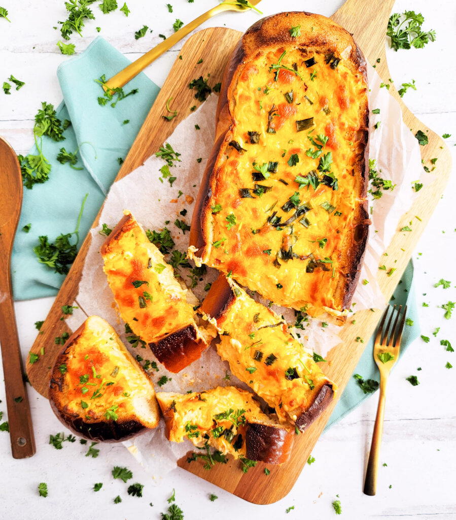 This Baked Buffalo Chicken Stuffed French Bread is packed with so much flavor; buffalo chicken dip baked into a French bread loaf topped with cheese and free onions  beautifuleatsandthings.com