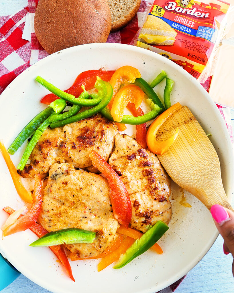 These Cheesy Chicken Fajita Sandwiches make for a hearty and delicious meal any time of day, made with bell peppers, chicken, cheese, on a whole wheat bun  beautifuleatsandthings.com