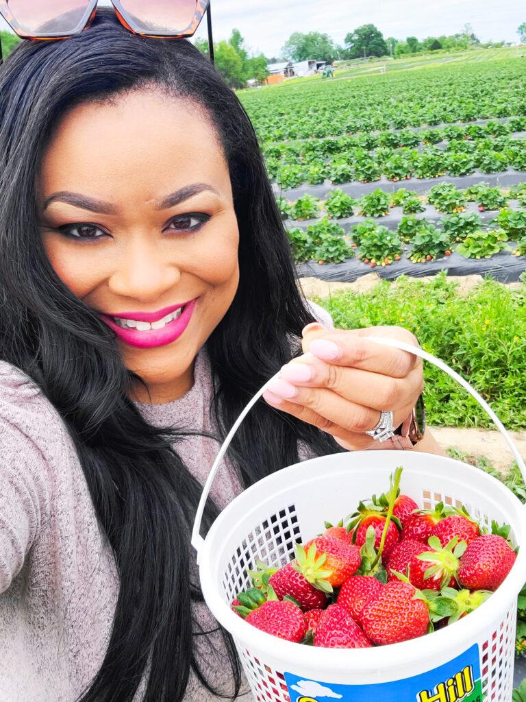 Black, African American , Registered Dietitian picking strawberries in a strawberry farm.  beautifuleatsandthings.com