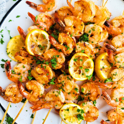 Cajun Garlic Butter Shrimp Skewer with lemon slices and parsley beautifuleatsandthings.com