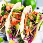 Try these Grilled Salmon Tacos topped with Blueberry Coleslaw, avocado, limes, and cilantro. perfect for taco night and taco Tuesday. beautifuleatsandthings.com