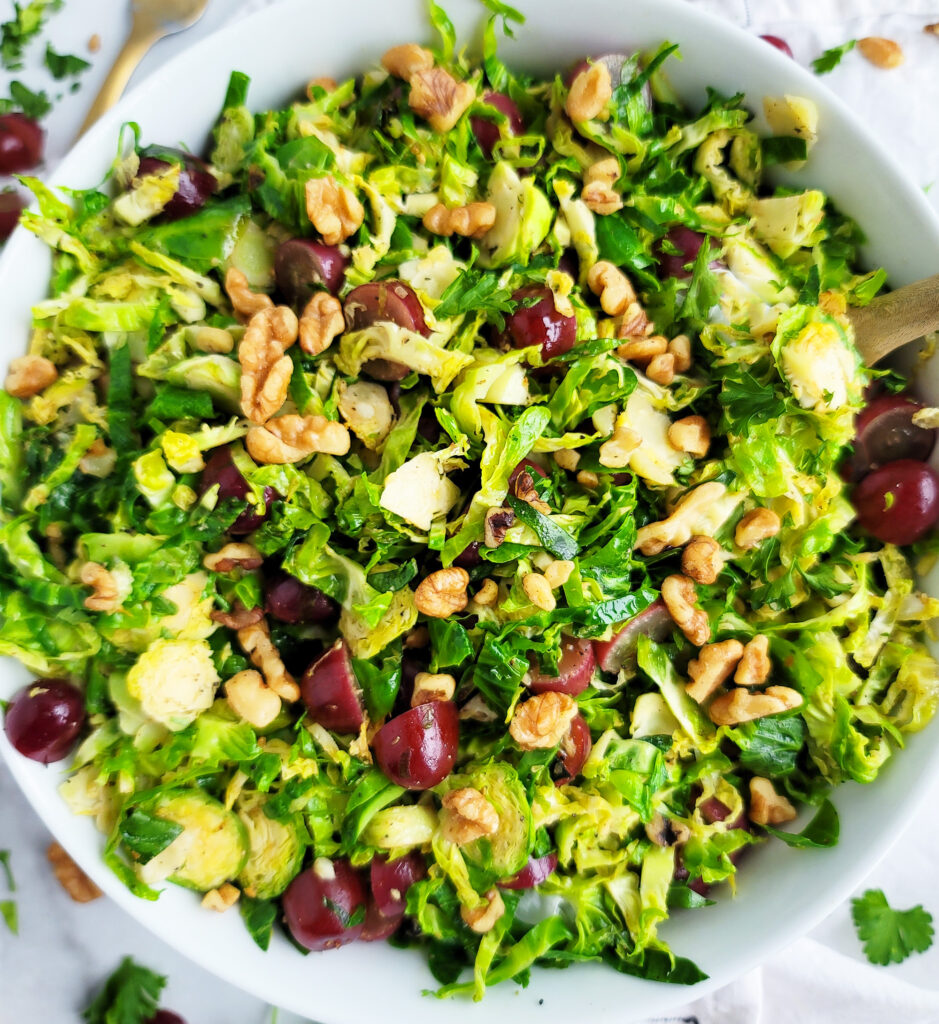 This Warm Grape, Brussels Sprouts, & Walnut Salad is the perfect combination of tangy, sweet and delicious, made with red California grapes, shredded Brussels sprouts, and walnuts.  beautifuleatsandthings.com