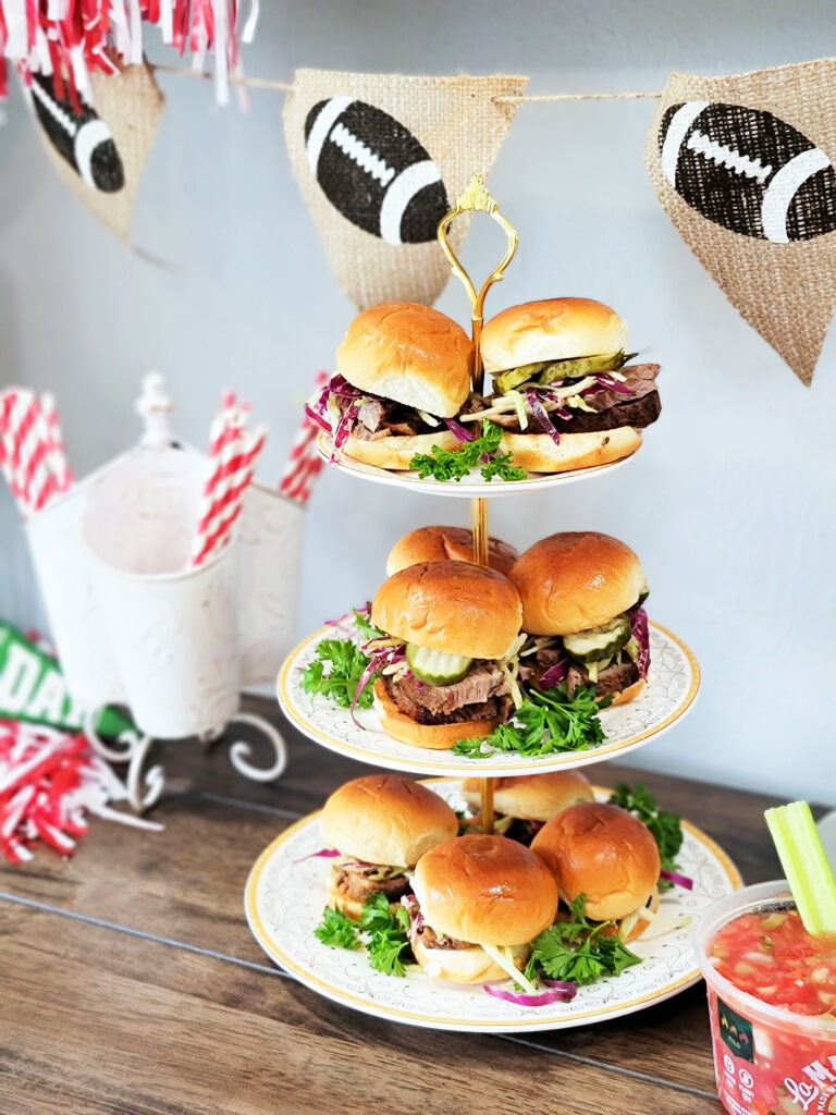Smoked Brisket Sliders with Marinated Coleslaw, sliced pickles on a white surface  beautifuleatsandthings.com